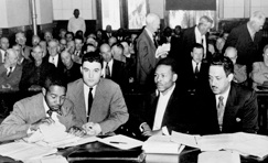 17 Feb 1952, Ocala, Florida, USA --- 2/17/1952-Ocala, FL: Seated in the crowded courtroom during the second trial of Walter Lee Irvin (Third from Left) are, Left to Right: Paul C. Perkins; Jack Greenberg, New York attorney for the NAACP; Irvin; and Thurgood Marshall, chief counsel for the NAACP. Irvin was sentenced to die in the electric chair after being found guilty on a charge of rape. Irvin is one of the four Negroes charged with kidnapping a young Florida housewife anf raping her. --- Image by © Bettmann/CORBIS